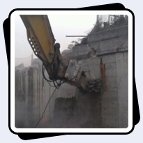 Antraquip AQ-4 Concrete Grinder on CAT330 Reinforced Concrete Wall Demolition