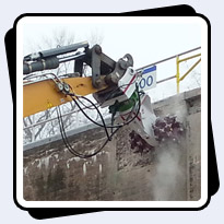 AQ-4W on Liebherr 954 with AQR4 rotation unit on Liebherr 954 Lock and Dam Concrete Removal