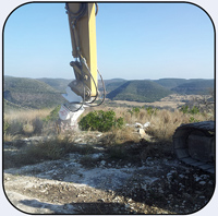 AQ-3XL on CAT320 Land Development rock removal in Texas.