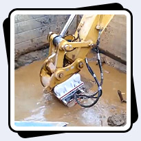 AQ-4 cutter on CAT330 cutting granite underwater in neighborhood near Baltimore, MD.