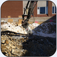 AQ-4 on EC330 Rock Excavation for Hospital Expansion.