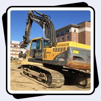 AQ-4 on EC330 Rock Excavation for Hospital Expansion.