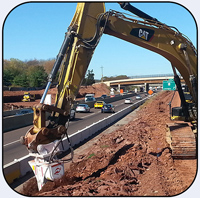 AQ5 on CAT349 rock removal for highway expansion.