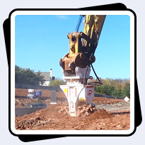 AQ5 on CAT349 rock removal for highway expansion