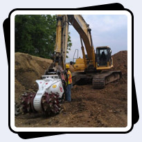 AQ5 on PC400 Trenching 15,000-18,000psi Limestone in Northern Indiana.